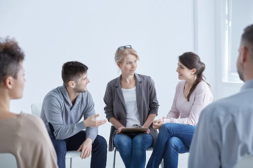 Psychotherapy utilized in addiction treatment during group sessions.