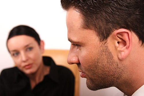 man participating in talk therapy with his therapist