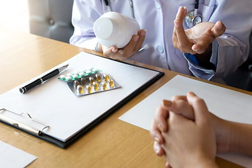 doctor discussing medication therapy management with patient